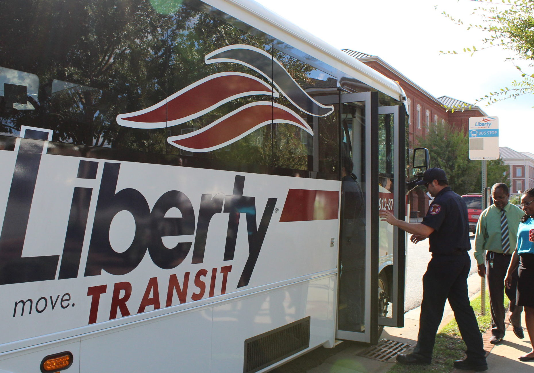Riders getting on Liberty Transit
